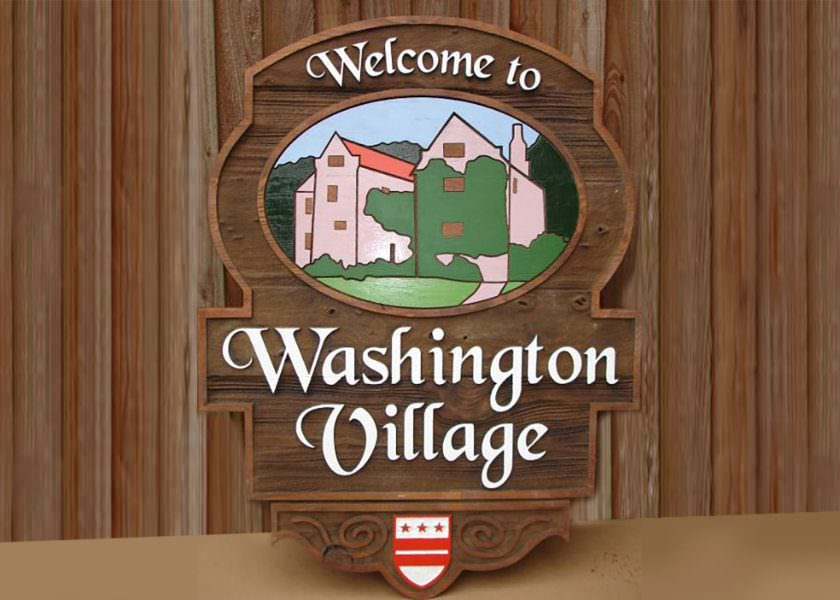 Timber Village entrance sign produced in sandblasted cedar wood