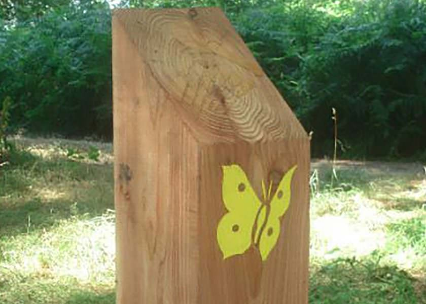 Large timber bollard with sandblasted butterfly