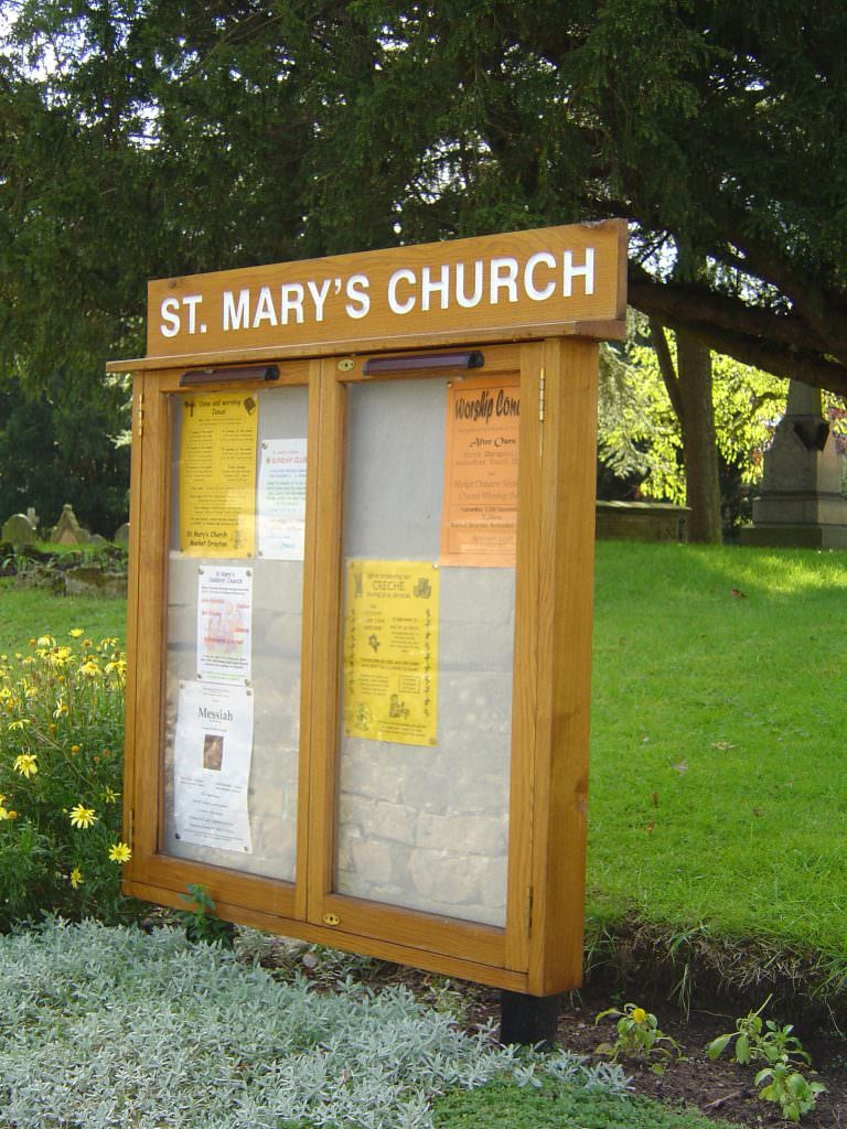 A Church yard notice board with twin doors and a pinboard backer. Supplied with low level posts and a routed header panel
