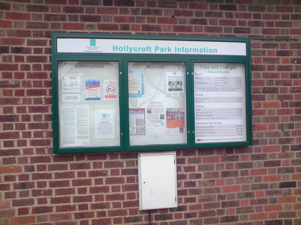 A park information notice board with 3 lockable doors and a separate header panel. Produced in aluminium with a pinboard backer. Wall mounted.