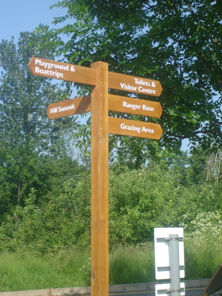 A multi- arm oak finger post with 5 directional arms to guide visitors. All timber oiled and the routed text painted white