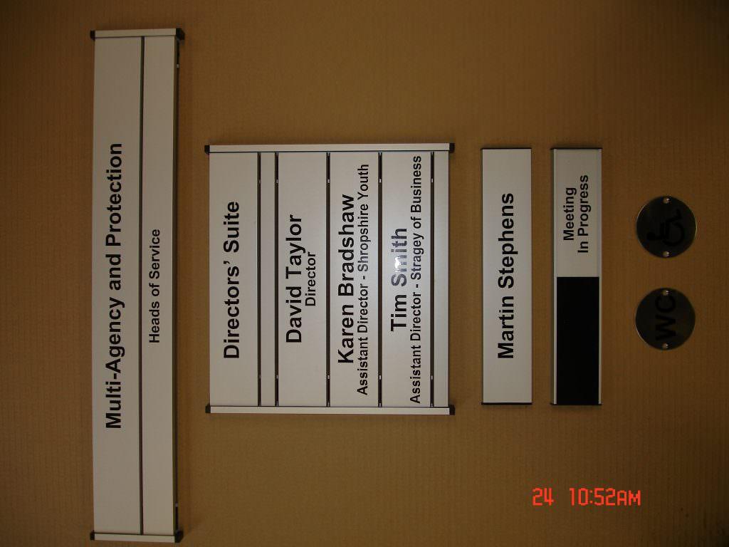 A series of aluminium door signs with vinyl lettering