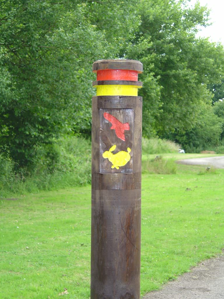 A round trail bollard in softwood – supplied with 2 routed bands and a rabbit & owl routed image to highlight the trail route