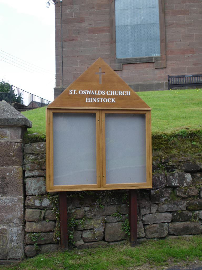 An lockable Oak notice board with routed header panel and posts for a Church to display changeable information