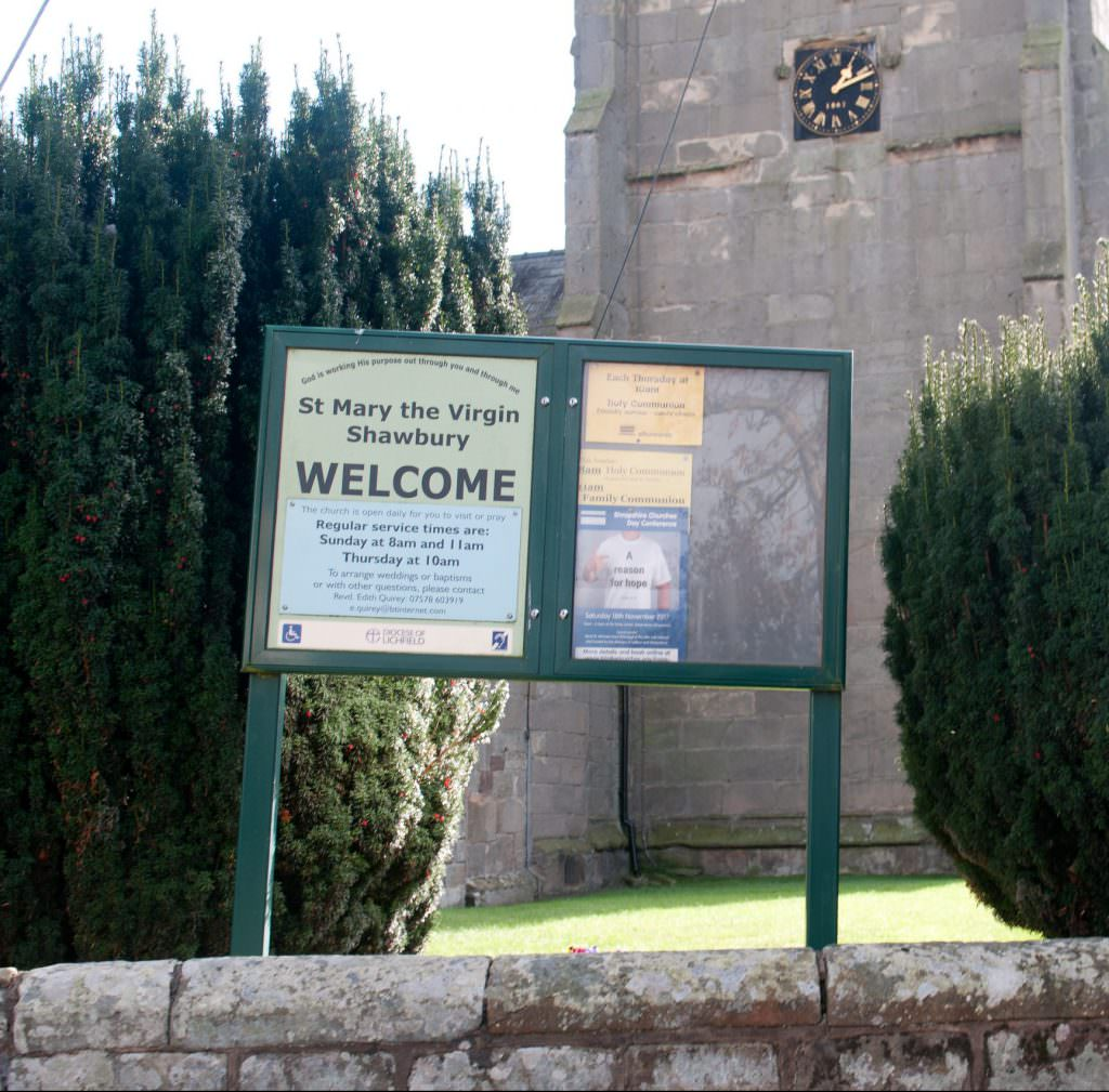 An aluminium Church notice board with twin doors – one side displaying permanent information, the other side changeable