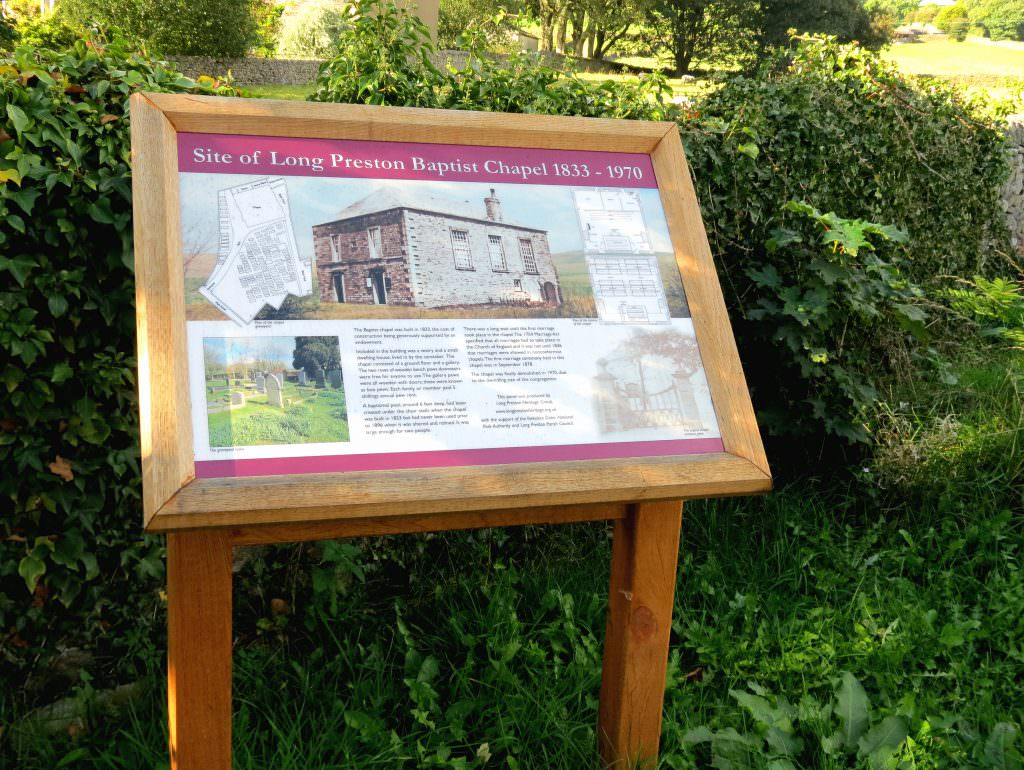 A Church yard interpretation panel in an oak lectern frame – the content providing information about the Church building & natural history