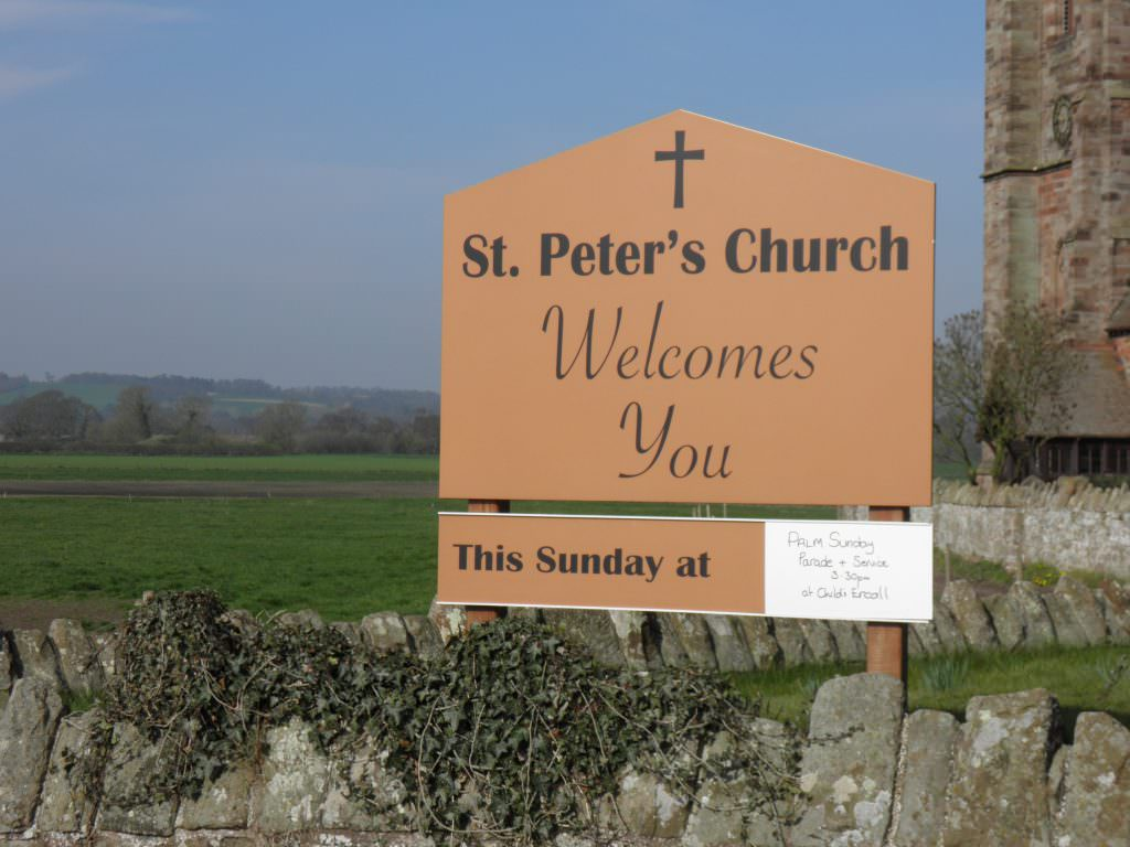 A simple Church Welcome & Entrance sign supplied with timber posts and a slide system to display Next Service times