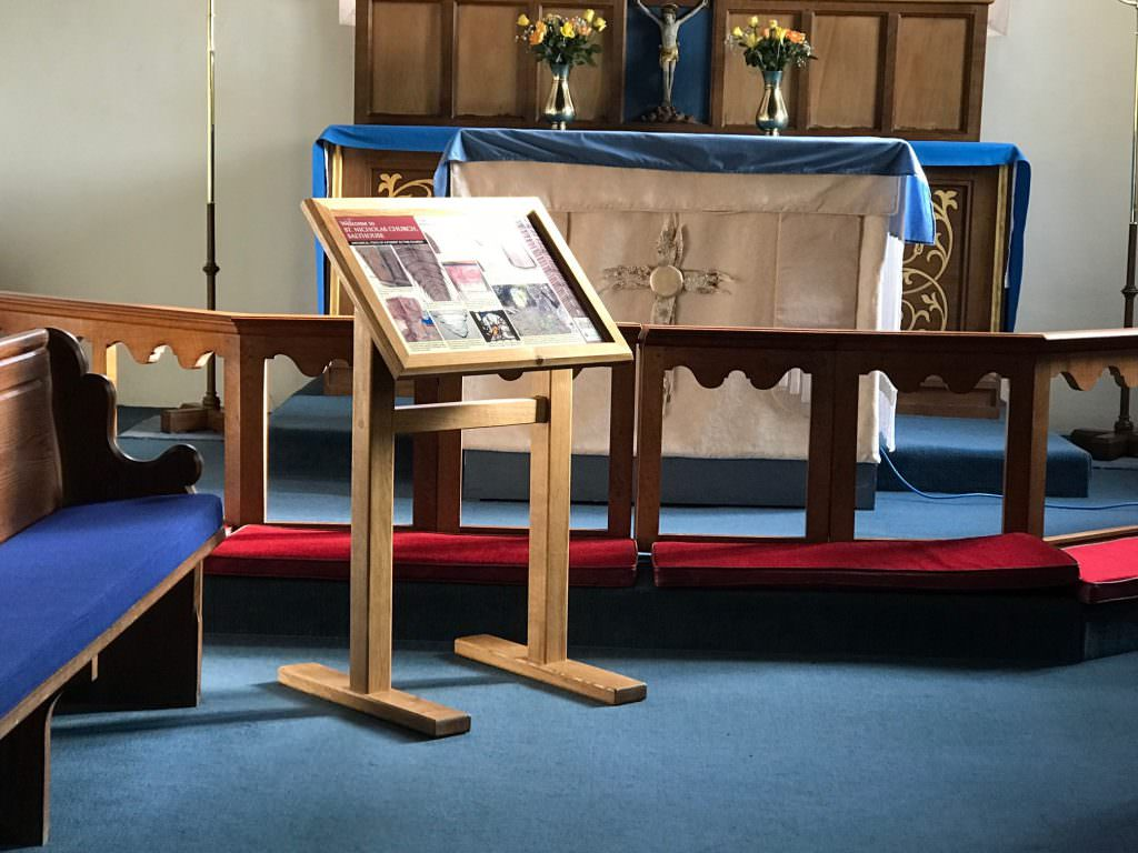 An internal Church interpretation panel supplied with a free-standing lectern frame. The design provides information about Church architecture