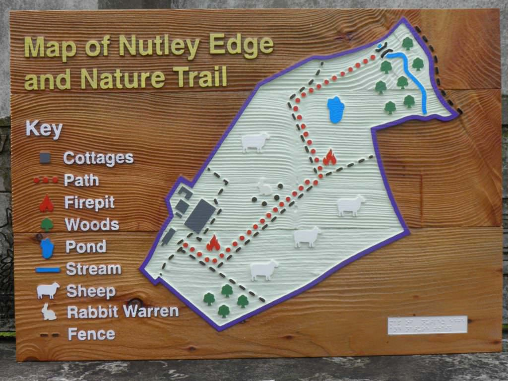 Good example of a tactile sandblasted map panel at a Nature Reserve.  The map shows various walks along with features of interest