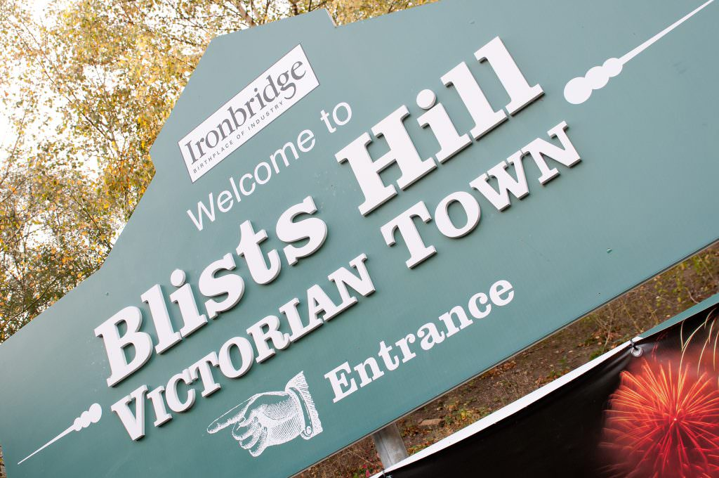An imposing Museum entrance sign with a profile cut out to the shape of the museum buildings and individual cut out lettering