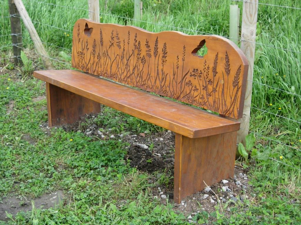 A sandblasted timber bench produced in Cedar with wildlife illustrations sandblasted onto the backrest to provide visitor interpretation