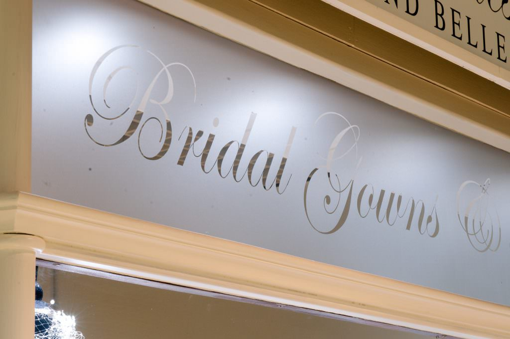 Pre-cut etched vinyl lettering  positioned in the windows of a bridal shop in Shrewsbury