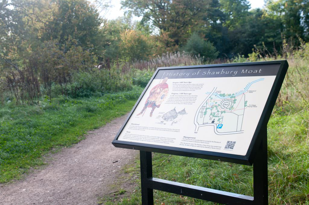 A natural history interpretive sign with a metal lectern frame. Introducing the natural history in the area.