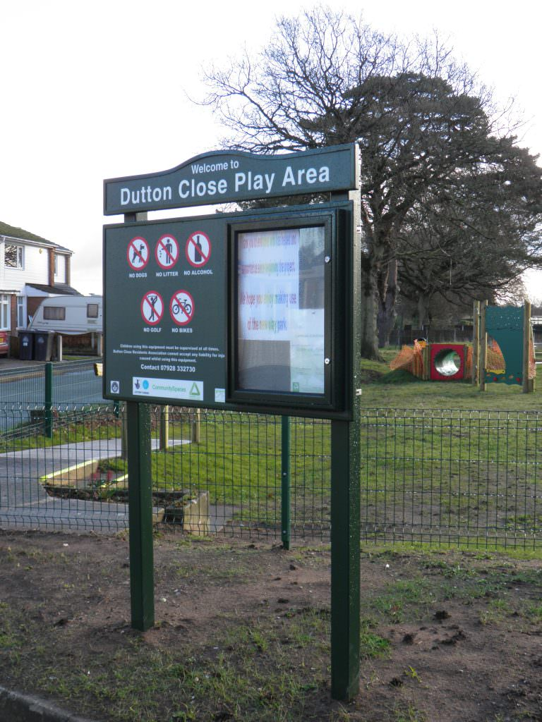 A park or play area entrance sign complete with prohibition symbols, a lockable notice board, separate header panel and posts