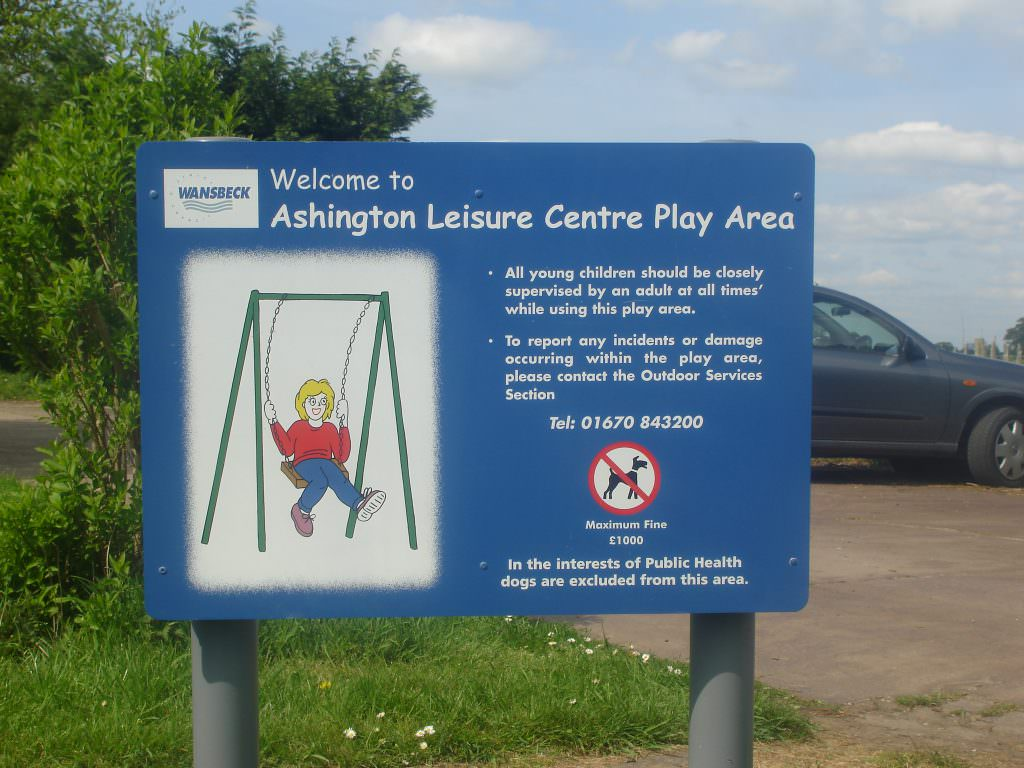 A simple post mounted Play Area sign complete with metal posts. The design includes an illustration of a child playing on a swing, rules & contact details
