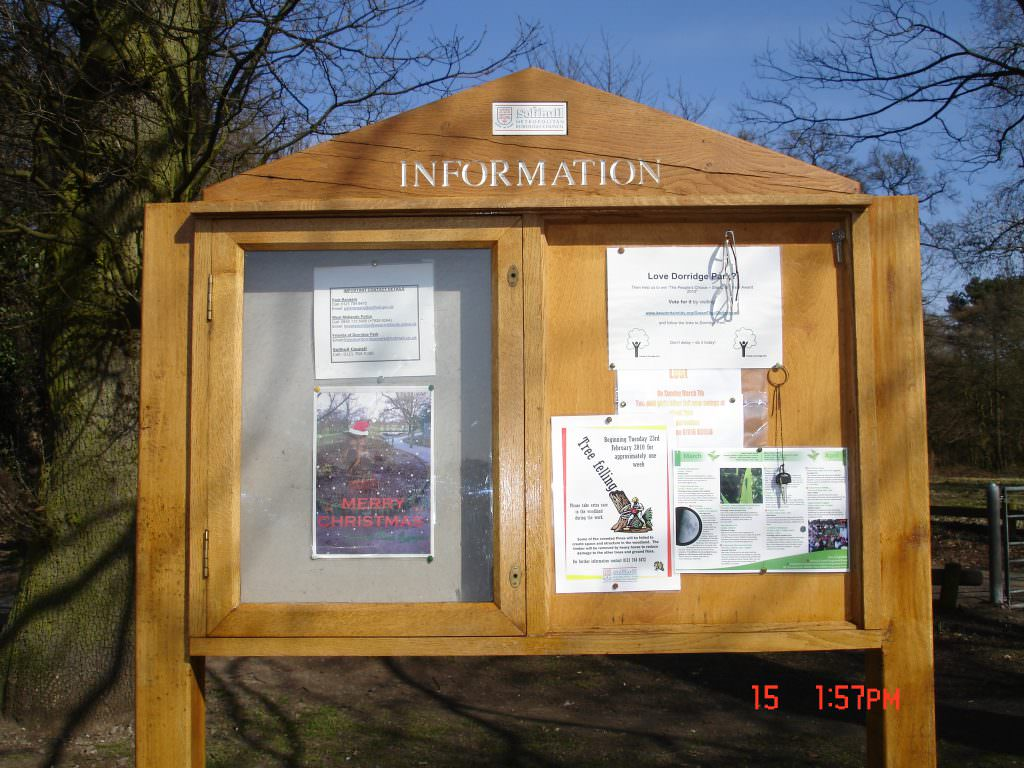 An oak welcome sign for a rural nature reserve. One half consists of a lockable notice board and the other an open pinboard. Posts & header panel.