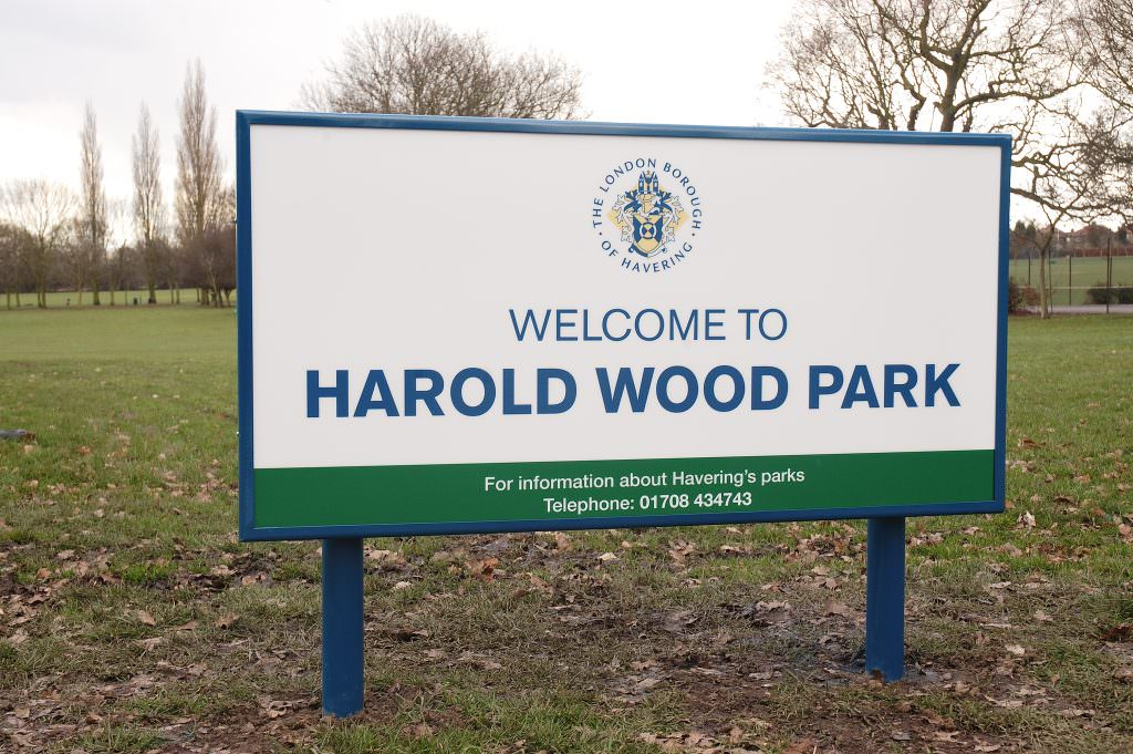 A park entrance sign with an aluminium frame & posts. The design giving a Welcome message and contact details.
