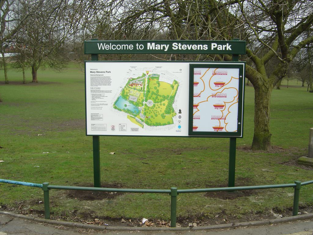 An urban park entrance sign with a park map, lockable notice board and separate header panel. With aluminium frame & posts