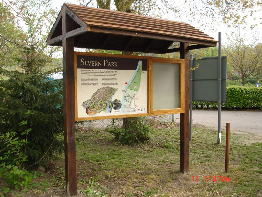 A park entrance sign complete with softwood lockable notice board set in a pitched roof shelter for protection and to create a feature in the park.