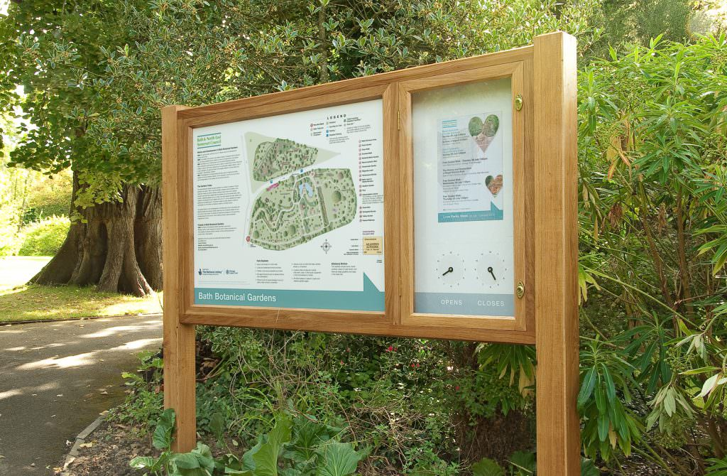 An interpretation board or sign explaining facilities in a public park complete with a lockable oak notice board & a changeable clock for opening times