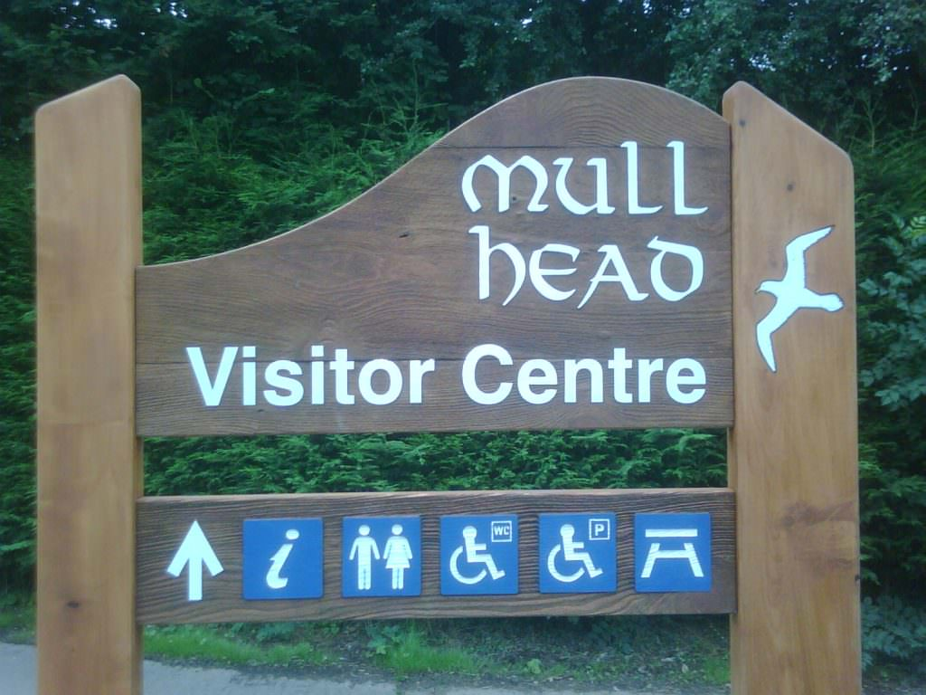 A sandblasted timber nature reserve entrance sign – supplied with 2 shaped planks, sandblasted text and a bird illustration on one post