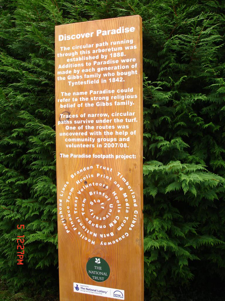 A sandblasted timber interpretation or information sign providing information about the circular paths at Paradise Arboretum