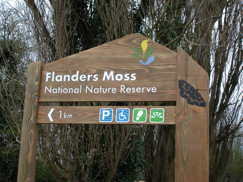 A sandblasted National Nature Reserve entrance sign with 2 planks.  Produced in Cedar with side mounted posts.