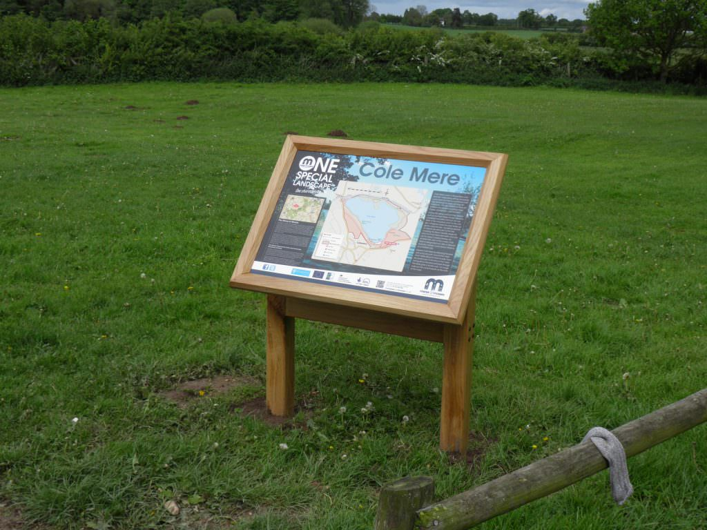An A2 size interpretation panel or sign explain the importance of the Meres & Mosses project in Shropshire. Information sign mounted in a twin leg oak lectern frame