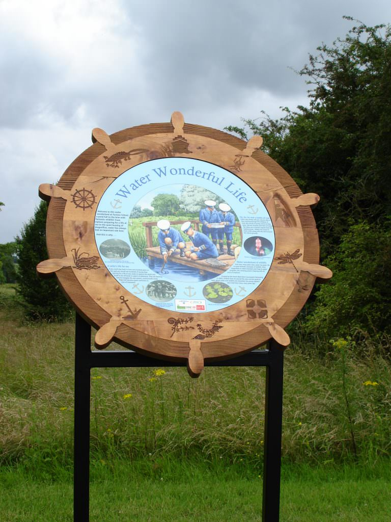 A sandblasted information sign produced in the shape of a ships wheel.  Supplied with a full colour interpretation panel and sandblasted images