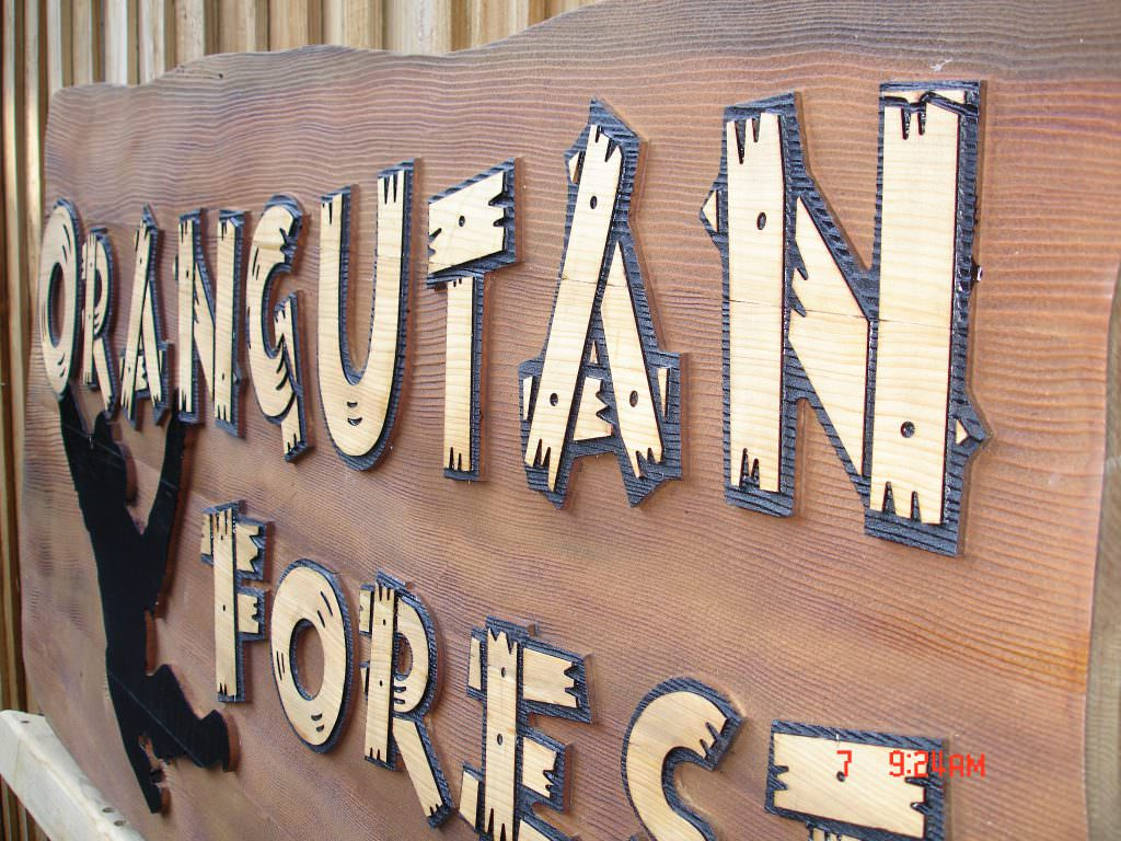 Close up of a tactile sandblasted entrance sign for the Orangutan enclosure at Colchester Zoo